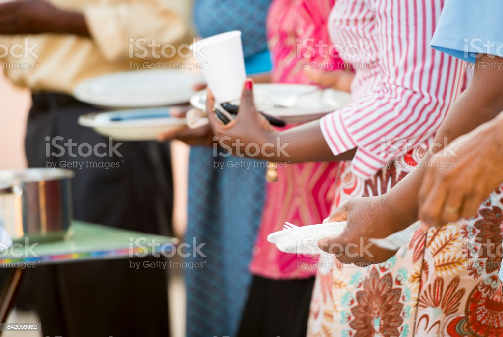 People Queue For Food stock photo
