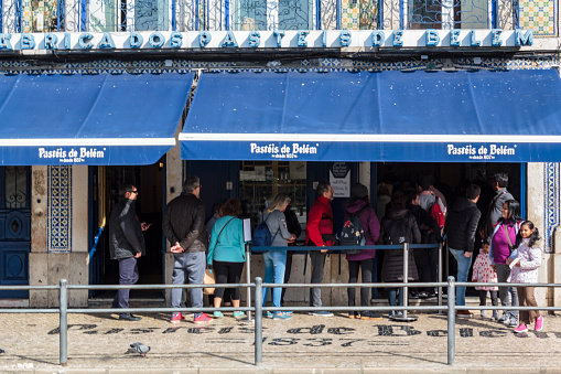 People queue in front of famous Pasteis de Belem bakery in Lisbon