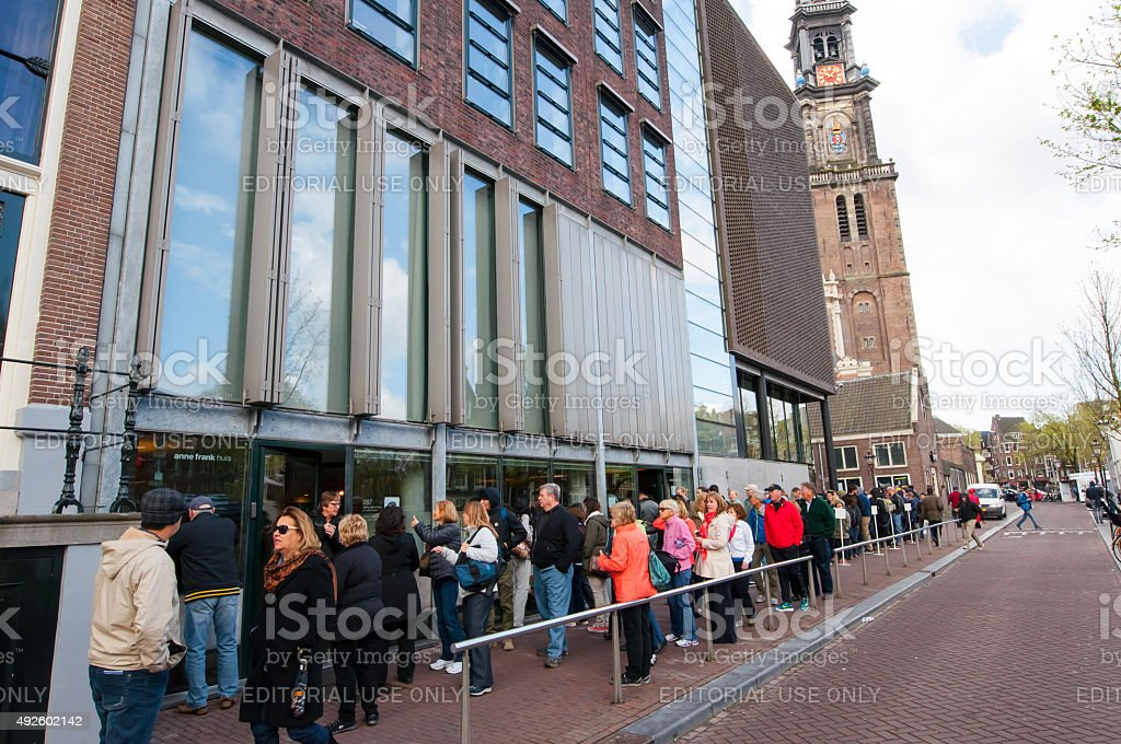 People queue up to the Anne Frank House Museum. Amsterdam. stock photo