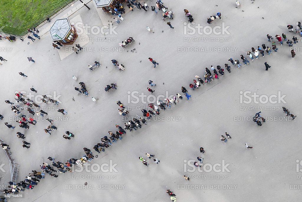 People queueing at the Eiffel Tower royalty-free stock photo