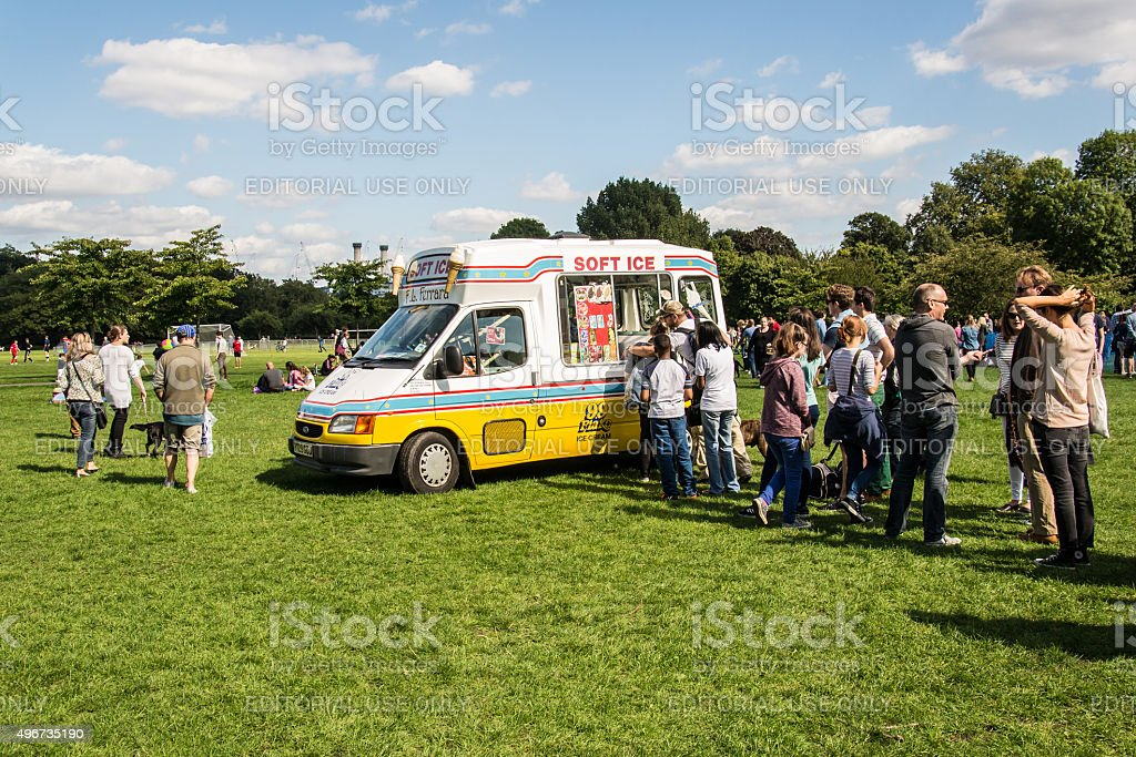 People queueing in front of an ice-cream van stock photo