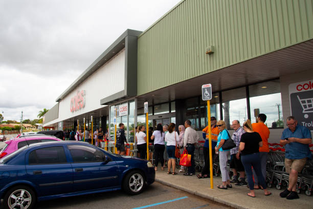Perth, Australia - March 15, 2020: People queuing at Coles grocery store during the Coronavirus crisis stock photo