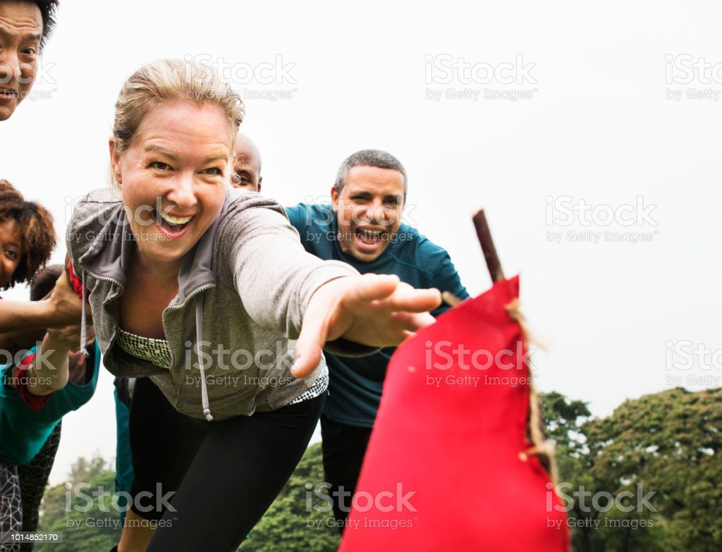 People racing to catch a flag stock photo
