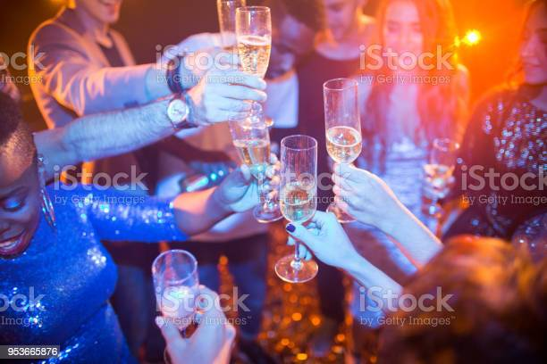 People raising glasses at club party picture id953665876?b=1&k=6&m=953665876&s=612x612&h=gptvkhlmx1zy0ct6qooowny8u 75oyyubrmq4bsz4ly=