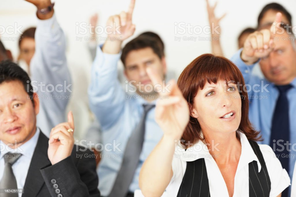 People raising hands at business conference royalty-free stock photo