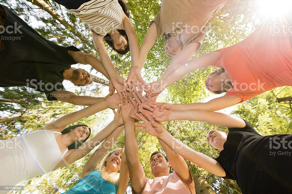 People Reaching Out Touching stock photo