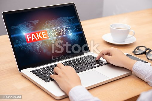 people reading fake news or HOAX on internet content via laptop
