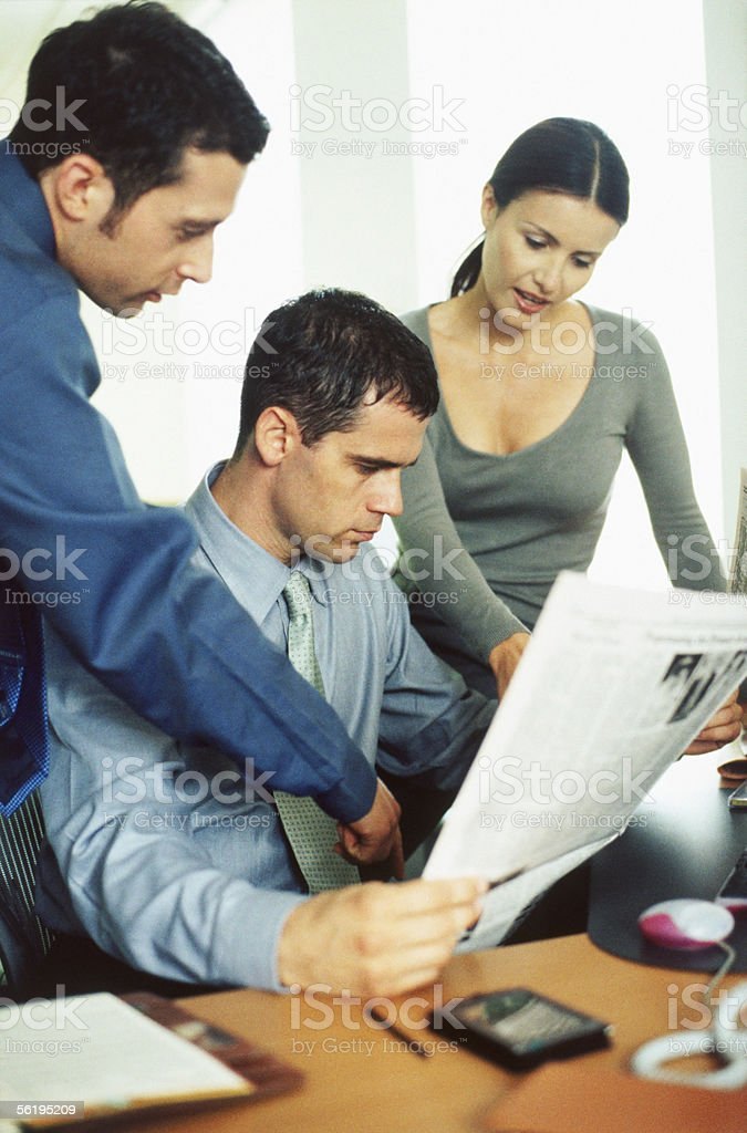 People reading newspaper royalty-free stock photo