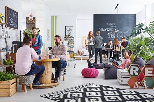 istock People realxing during lunch break 660311458