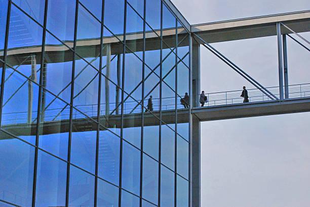 People reflected in windows of Marie Elisabeth Lüders Haus stock photo
