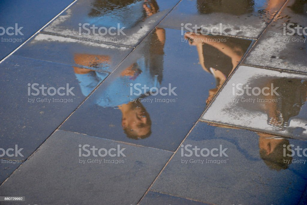 People Reflections in Wet Concrete stock photo