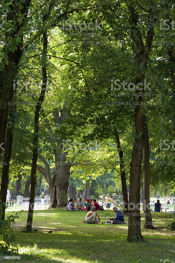 People relax at Englischer Garten in Munich, Germany royalty-free stock photo
