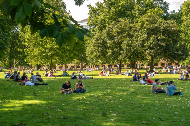 people relaxin on a sunny day in St. James's Park, London, UK stock photo