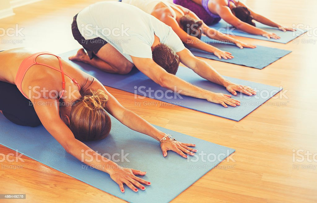 People Relaxing and Doing Yoga stock photo