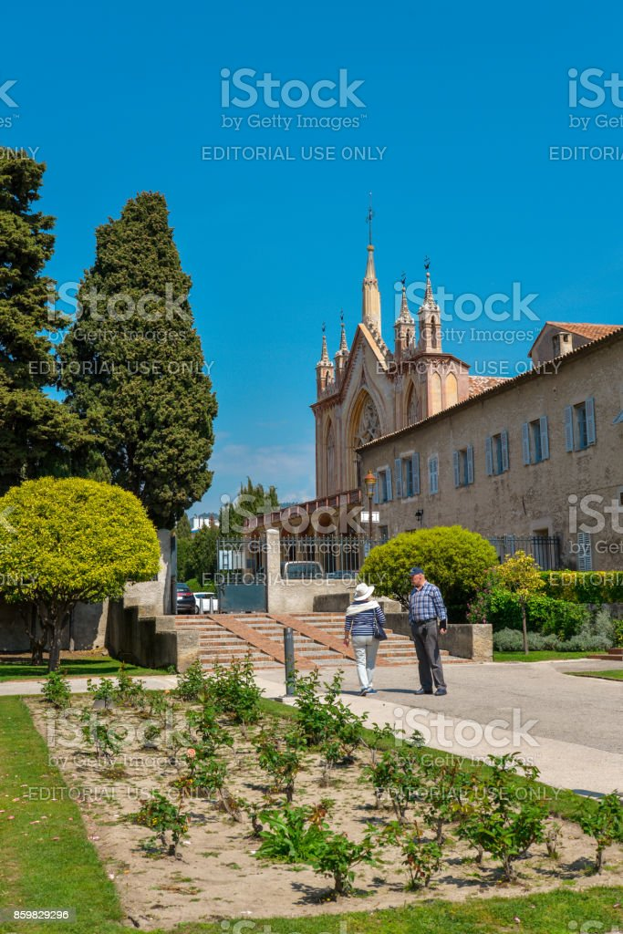 People relaxing at garden Franciscan monastery stock photo