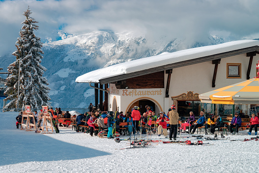 People relaxing at restaurant at Zillertal Arena in Austria