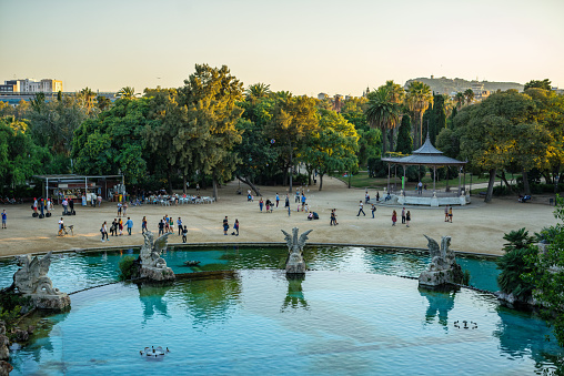 People relaxing in Parc de la Ciutadella at sunset