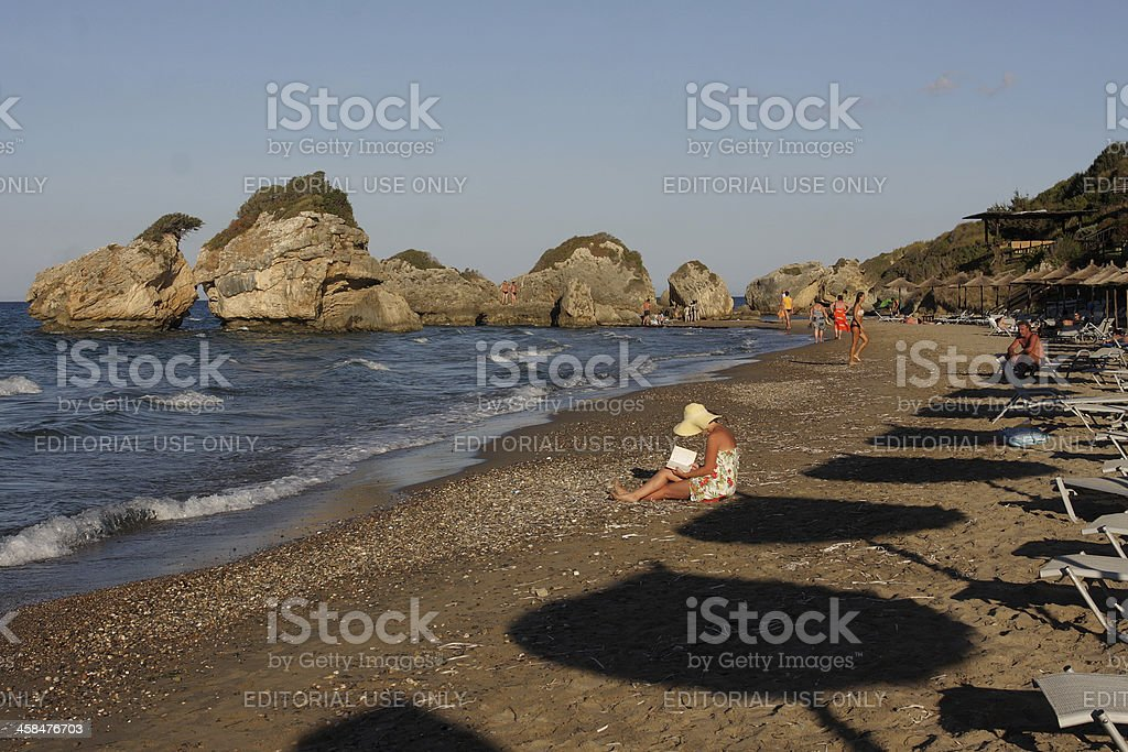 People Relaxing on a Greek Beach stock photo