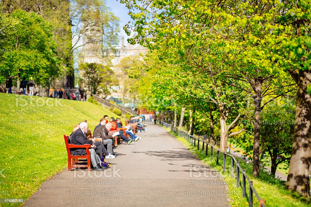 People Relaxing on Benches in Princes Street Gardens, Edinburgh stock photo