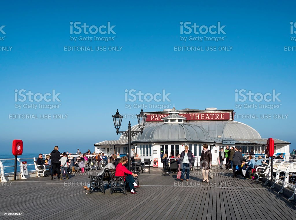 People relaxing on Cromer Pier in autumn stock photo