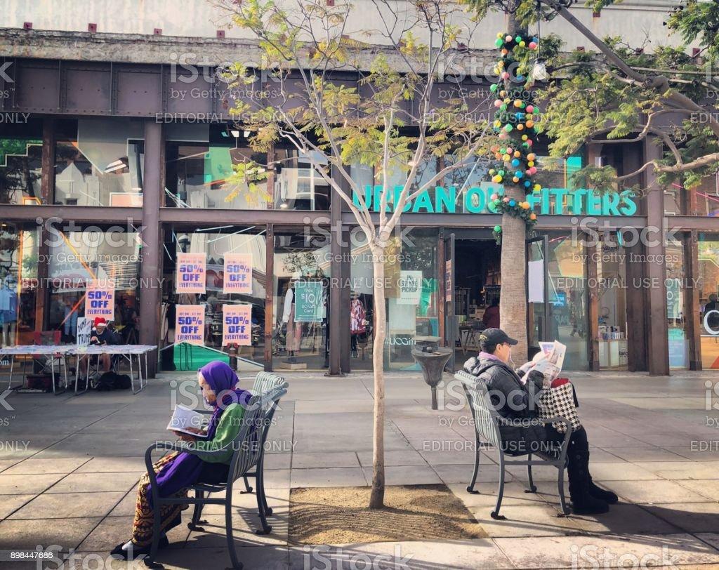 People relaxing on Third Street Promenade, Santa Monica, USA stock photo