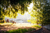 27 may 2018: woman resting in a bench in front of vltava river in Prague. Czech Republic