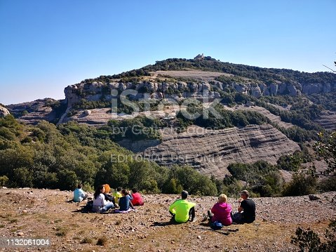 February 24, 2019 - Catalonia, Spain: People resting in front of La Mola mountain in Sant Llorenç del Munt Natural Park