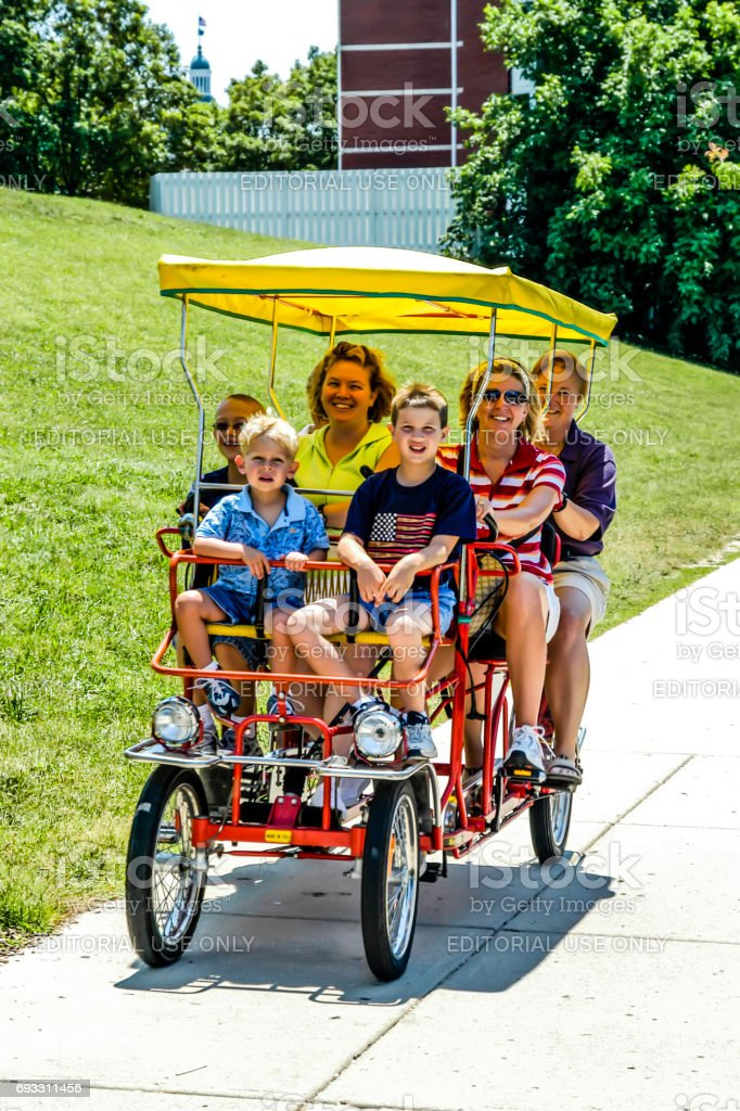 People riding a quad-bicycle in the park in Indianapolis, IN stock photo
