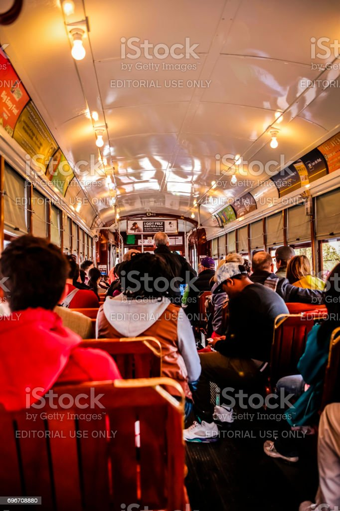 People riding a streetcar in New Orleans Louisiana, USA stock photo