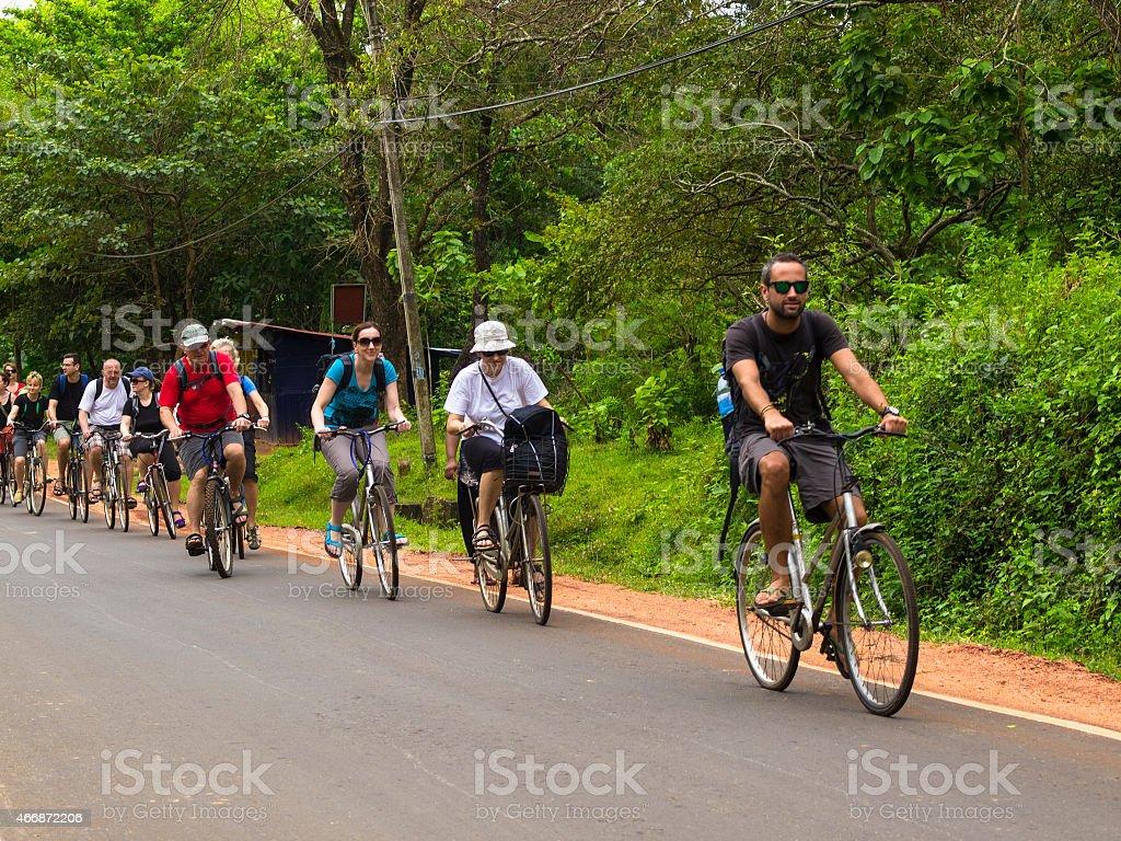 People riding bikes in Anuradhapura stock photo