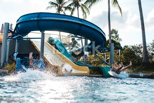 People riding down the water slides at a water park