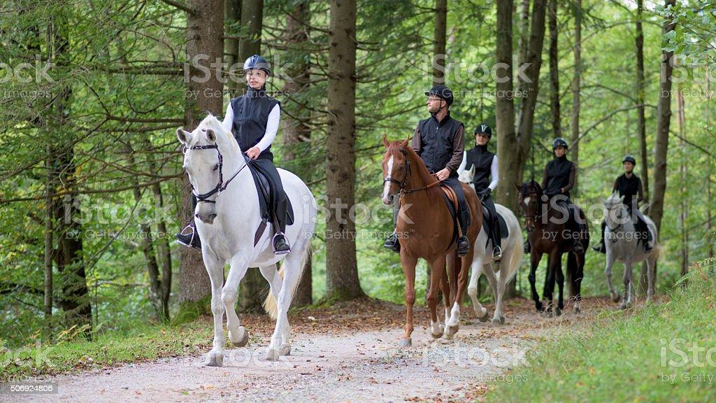People riding horses stock photo