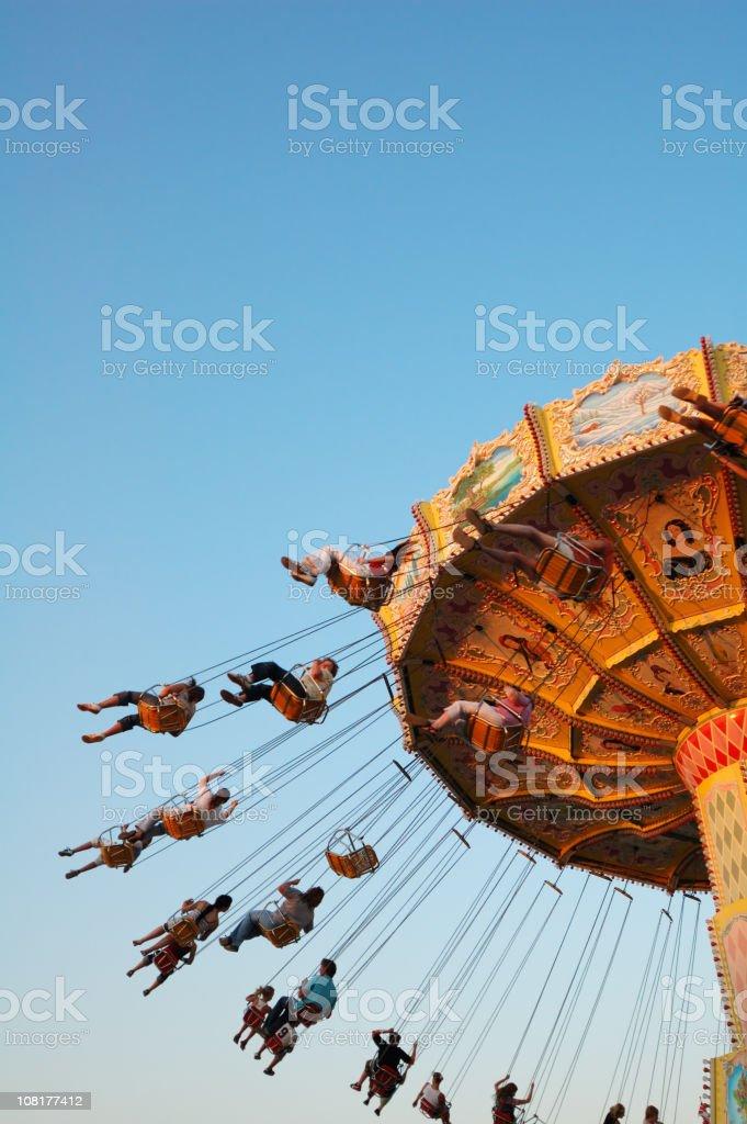 People Riding Swing Carousel royalty-free stock photo
