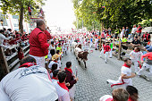 Pamplona, Spain - July 13: People run from bulls on street near of the bullring in the San Fermin festival in Pamplona, Spain on July 13, 2015