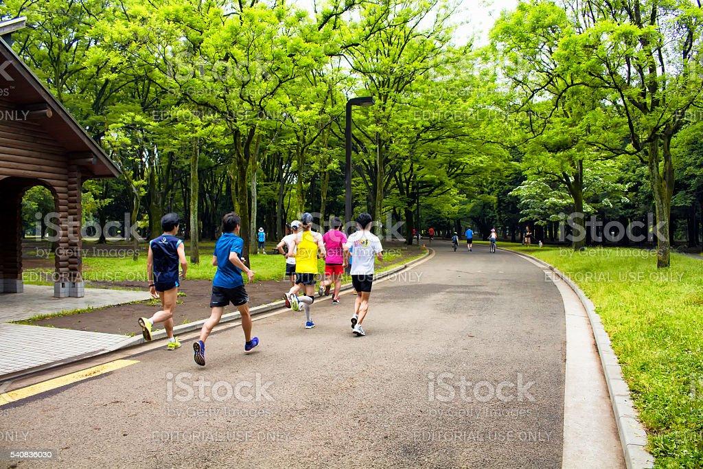People run in nature at Yoyogi park stock photo