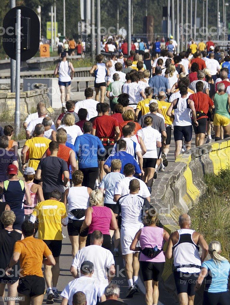 People running a marathon royalty-free stock photo