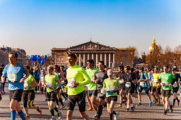 People running during the Marathon of Paris 2016 stock photo