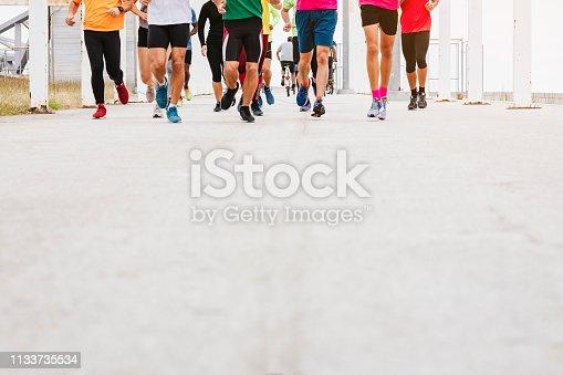 istock People Running Exercise park outdoor Marathon event 1133735534
