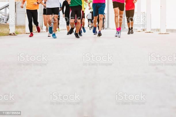 People running exercise park outdoor marathon event picture id1133735534?b=1&k=6&m=1133735534&s=612x612&h=pjbndf k6tj g8vd7ace93ytryjtesvufr qv1exr9q=