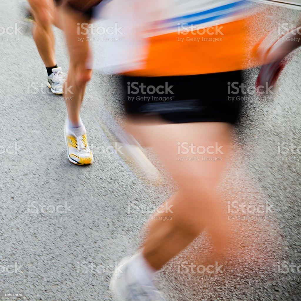 People running in city marathon - motion blur royalty-free stock photo