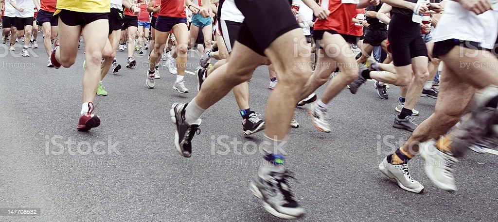 People running in city marathon royalty-free stock photo