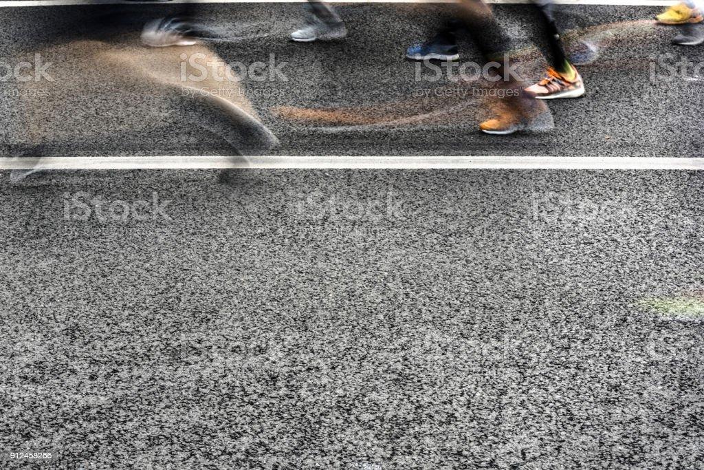 People running in marathon on city streets. Motion blur. stock photo