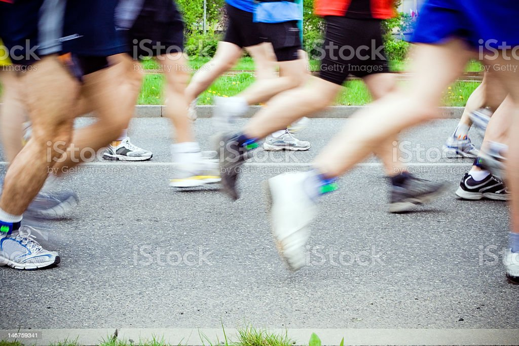 People running in marathon on city streets royalty-free stock photo