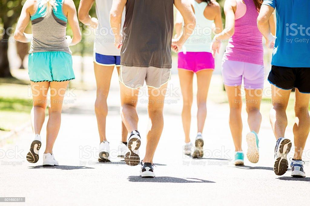 People Running Marathon In Park stock photo