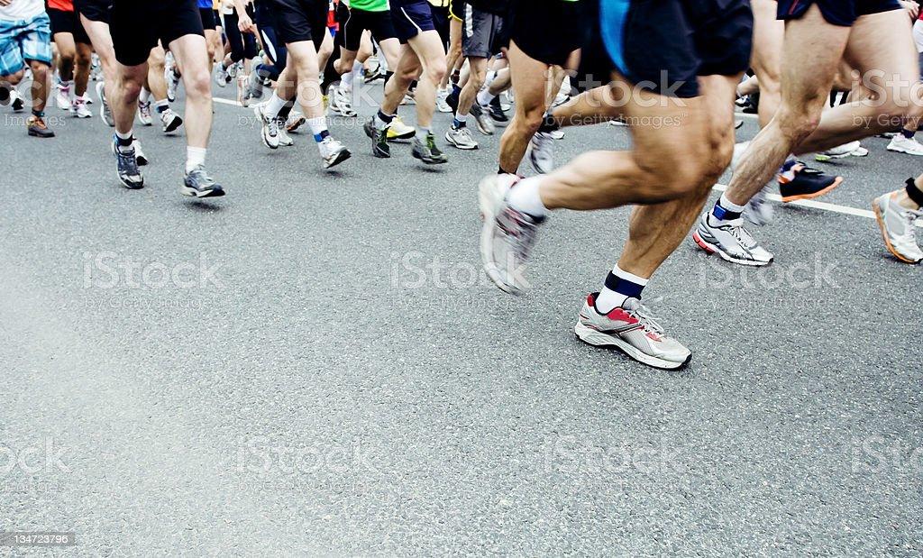 People running marathon together on street stock photo