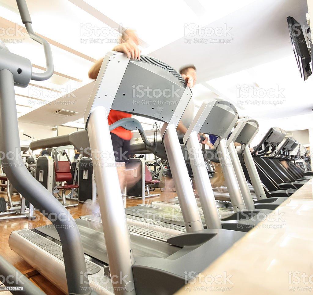 People running on treadmills stock photo