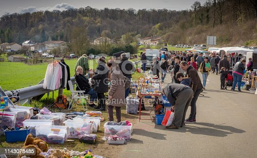 People selling and buying on Annual Rural brocante market (thrift 2nd hand boot sale) in Provenchères sur Marne, in the Haute Marne, France.