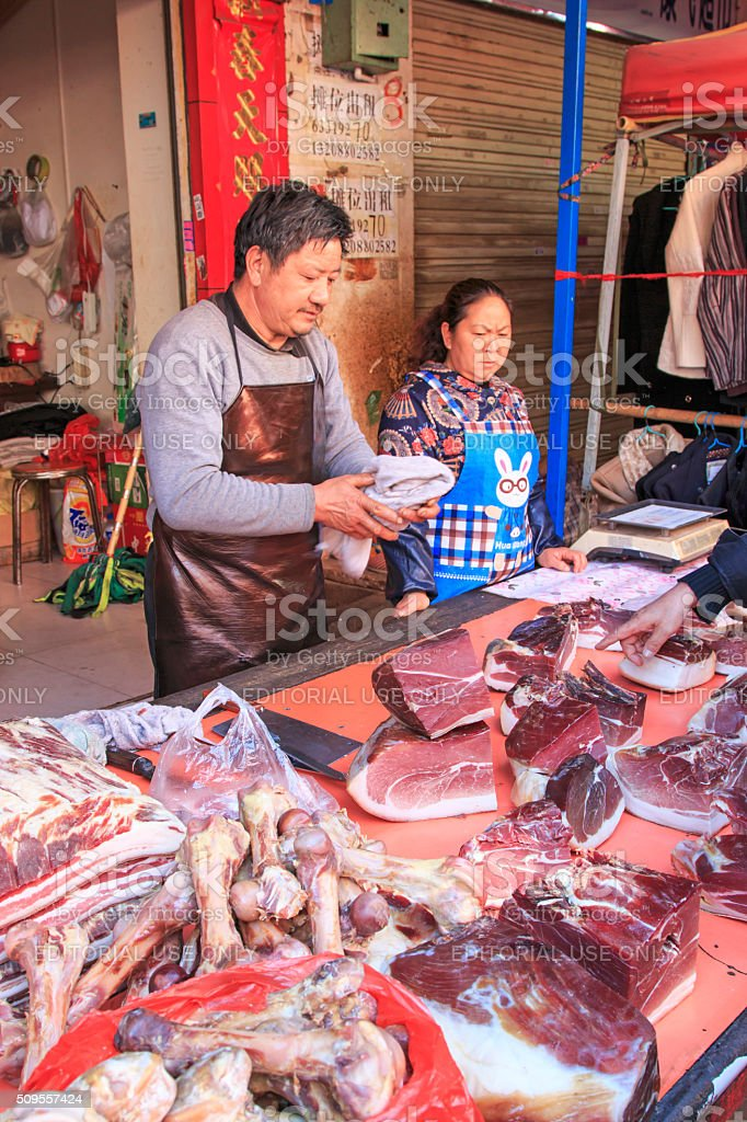 People selling and buying in a traditional market in the center of...
