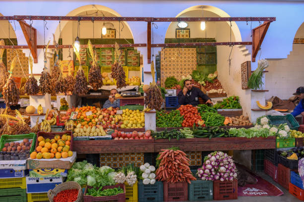 People selling fruits at the market on the medina of Sousse in Tunisia stock photo