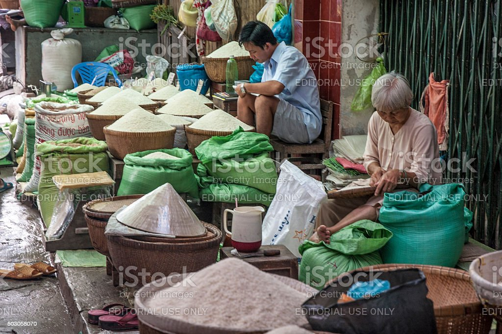 People Selling Rice At Market In Vinh Long, Vietnam stock photo